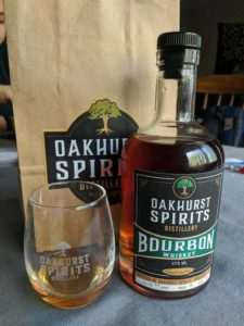 Bottle of Oakhurst Spirits Whiskey and glass