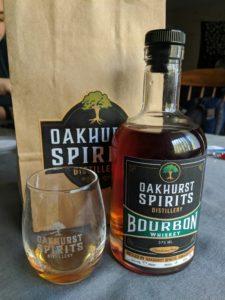 Bottle of Oakhurst Spirits Whiskey and glass